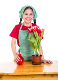 Girl care flowers in pot Royalty Free Stock Photos