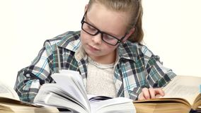 Girl carefully read and write data to the notebook. White background. Close up stock video