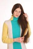 Girl cares for beautiful hair. Stock Photo