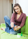 Girl cares for toenails Stock Images