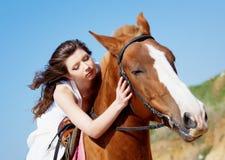 Girl caress her horse Stock Photos