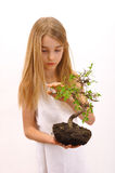 Girl caress tree Royalty Free Stock Image
