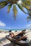 Girl in Caribbean beach Stock Images