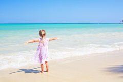 Girl caribbean  beach outdoors arms wide open Royalty Free Stock Photo