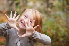 Girl with caries smiles. The girl with caries smiles early autumn Royalty Free Stock Photography