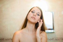 Girl caring for her face Royalty Free Stock Photography
