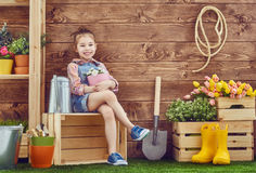 Girl caring for her plants Royalty Free Stock Photo