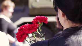 Girl with carnations. Victory day celebration in Yaroslavl, Russia. stock footage