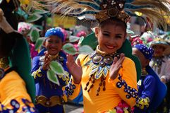 Girl carnival dancers in various costumes dance along the road Stock Photos