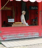 Vendor in antique costume in carnival, Fort Edmonton Park, Edmonton, Alberta, Canada Royalty Free Stock Image