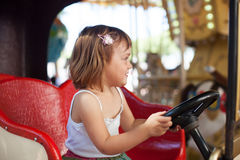 Girl in carousel car Stock Images