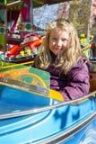 Girl on carousel Stock Photo