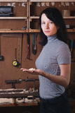 Girl-carpenter in the workshop, Royalty Free Stock Images