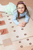 Girl on carpet Royalty Free Stock Photo