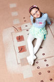 Girl on carpet. Cute young girl sits on carpet looking up Stock Photos