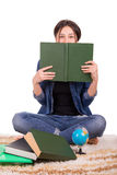 Girl on the carpet with books Stock Image