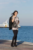 Girl carrier her jacket walking Royalty Free Stock Photography