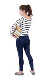 A girl carries a heavy pile of books. Royalty Free Stock Photos
