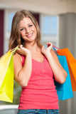 Girl carriing vibrant shopping bags Royalty Free Stock Image