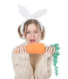 The girl with carrot Stock Photo