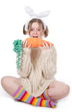 The girl with carrot Stock Images