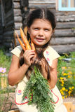 Girl with carrot Royalty Free Stock Images