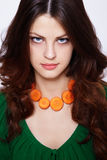 Girl with carrot necklace Royalty Free Stock Image