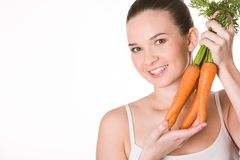 Girl with carrots Stock Images