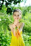 Girl with carrots Royalty Free Stock Photo