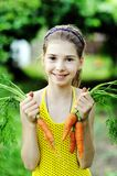 Girl with carrots Stock Image