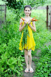 Girl with carrots Stock Photo