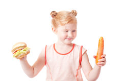 Girl with carrots and hot dog Royalty Free Stock Photos