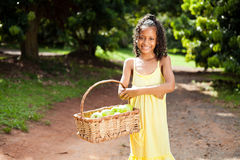 Girl carrying apples Royalty Free Stock Images