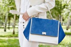 Girl carrying bag Stock Image
