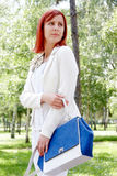 Girl carrying bag Royalty Free Stock Photography