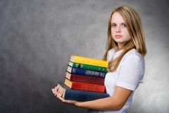 Girl carrying books. Portrait of a girl with books Stock Images