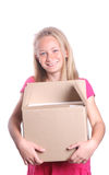 Girl carrying box Royalty Free Stock Images