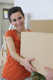 Girl carrying box Royalty Free Stock Photography