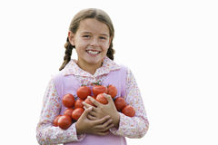 Girl carrying bunch of tomatoes, smiling, portrait, cut out Royalty Free Stock Image