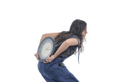 Girl is carrying a clock in her back. Stock Image