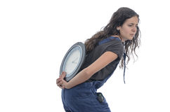 Girl is carrying a clock in her back. Stock Photos
