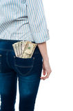 Girl carrying dollars in back pocket Royalty Free Stock Image