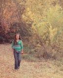 Girl carrying fishing pole Stock Photography