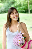 Girl carrying flowers Royalty Free Stock Photos