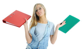 The girl carrying folders Royalty Free Stock Image