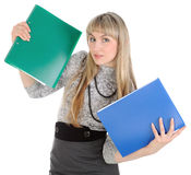The girl carrying folders. Royalty Free Stock Images