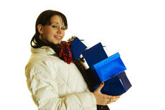 Girl carrying gifts Royalty Free Stock Photography
