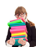 Girl carrying heavy stack books stock images
