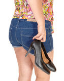 Girl carrying her heels. Stock Image