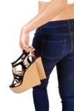 Girl carrying her heels. Stock Photos